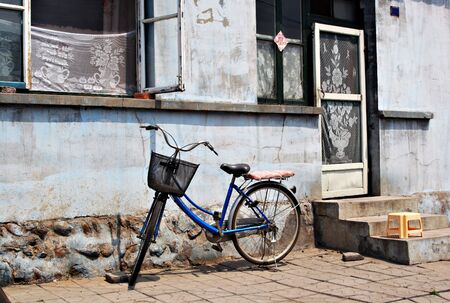 Bike in front of old house photo