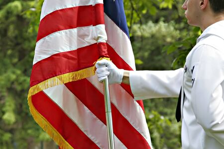 marine holding american flag Stok Fotoğraf