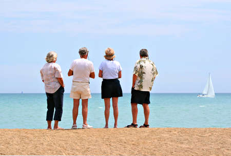 aged: retiree planning meeting by the beach   Stock Photo