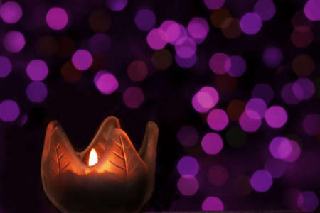 candle light on purple bokeh Stock fotó