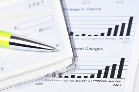 saving electricity: Check book on top of the gas billing statement