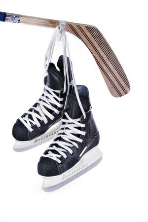 hockey skates and stick isolated