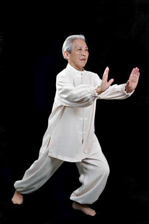 Chinese Elderly performing Tai Chi photo