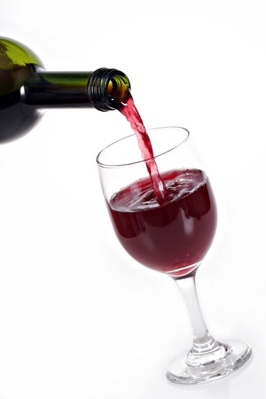 red wine pouring on white background Imagens