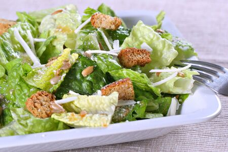 caesar salad with cheese and croutons photo