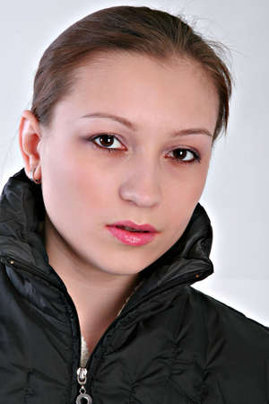 19 year old: Healthy Natural Looking 19 Year Old Girl in Black Jacket Stock Photo