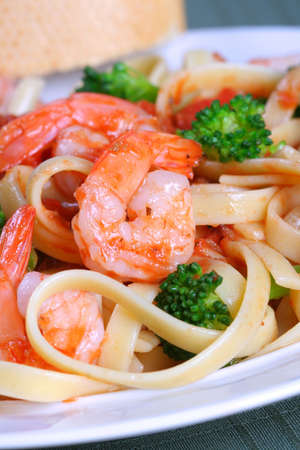 Fettuccine Pasta with Shrimp Dinner Dish and Vegetables photo