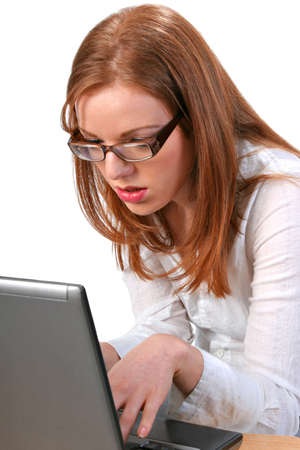 Serious Young Bussinesswoman Staring at the Computer photo