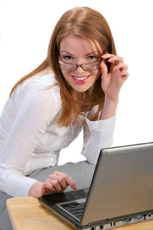Young Businesswoman in front of a Computer Isolated photo