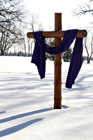 wooden cross: Wooden Cross Silhouette in Snow Field