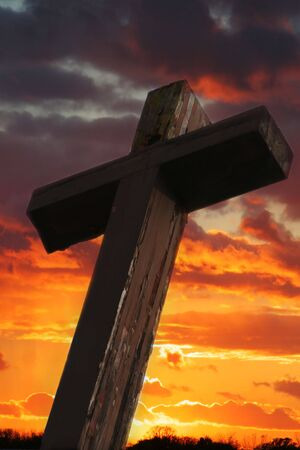 easter cross: Rustic Wooden Cross Against Dramatic Sunset Sky