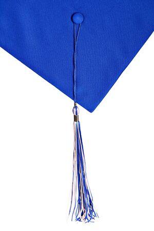 卒業帽子とタッセル孤立した背景にブルーします。 写真素材