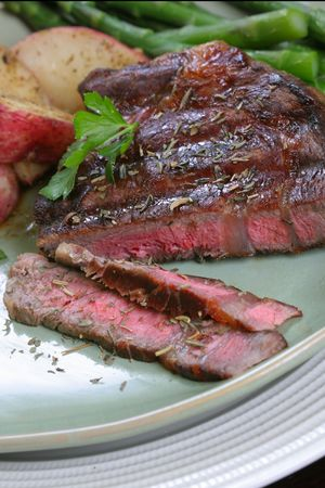 Grilled Beef Ribeye with Baked Potatoes Stock Photo
