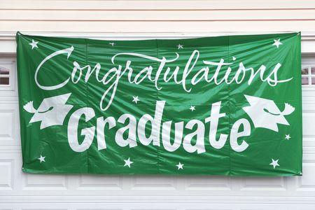 Graduation Congratulation Banner Hanging Outside Garage Door photo