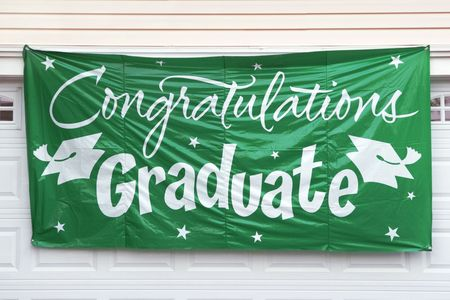 Graduation Congratulation Banner Hanging Outside Garage Door Imagens - 2727004