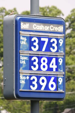 outrageous: Gasoline Price Sign at Outdoor Gas Station