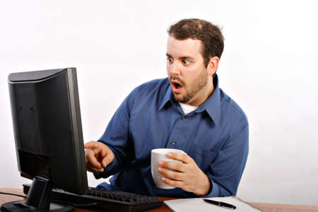 Terrified Worker Mouth Open Pointing to Computer photo