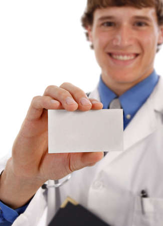 Young Doctor Holding Business Card - Shallow DOF photo