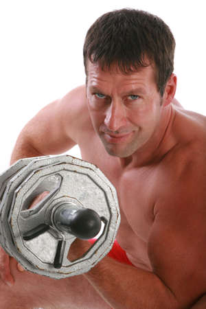 Healthy Looking Man Exercising with Weight Lifting Stock Photo - 3487308