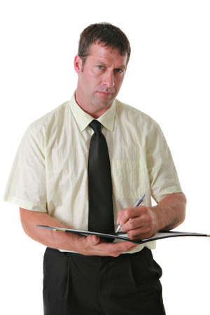 Serious Looking Businessman Writing Notes on Isolated Background photo