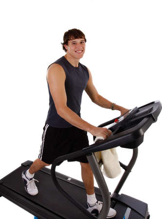Healthy Young Man Workout on Treadmill on Isolated background photo