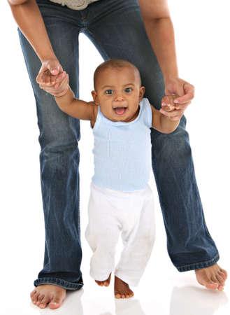 first step: Baby's First Step Mommy Holding Hands Lizenzfreie Bilder