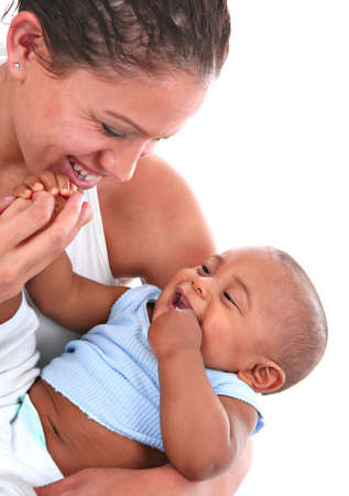 Smiling Mom Holding and Playing with Baby Stock Photo