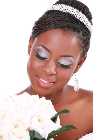 Beautiful Bride Holding Rose Bouquet with Eyes Closed photo