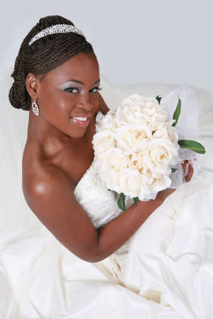 Beautiful African American Bride Portrait Sitting on White Background photo