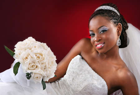 Beautiful African American Bridal Portrait on Red Dark Background photo