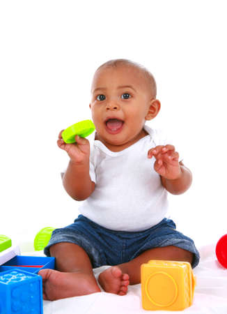 7-month old baby playing with toys on white background Stock Photo - 3993038