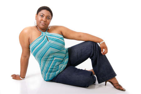 women in jeans: Cheerful Young African American Woman Dressed in Casual on White Background Stock Photo