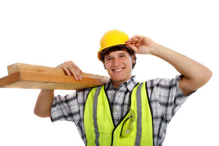 Young Happy Carpenter Holding Building Materials on Isolated Background photo