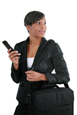 Young African American Businesswoman with Cellphone on Isolated Background Stock Photo - 4103226