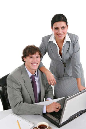 Two Smiling Young Businesspeople Working in Office photo
