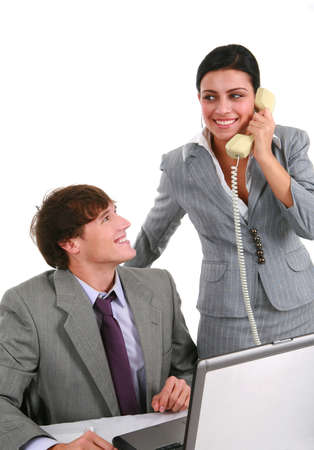 Two Smiling Young Business Persons Working in Office photo