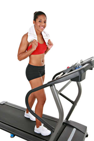 Healthy Happy Young African American Female Exercising on Treadmill Isolated Stock Photo