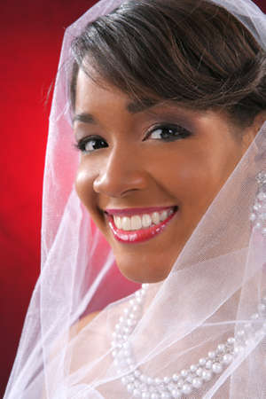 Beautiful African American Bride Headshot on Red Background photo