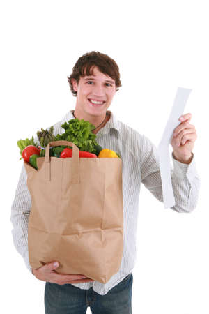 Smiling Healthy Looking Young Man Holding Groceries Paper Bag and Store Receipt Isolated Stock Photo