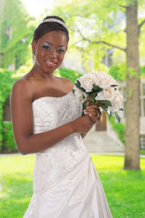 Beautiful African American Bride Portrait Outdoor infront of Church Building under Bright Sky photo