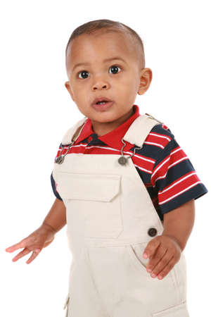 1-year old boby standing with curious expression looking at camera Stock Photo - 4541505