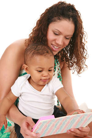 Smiling Mother and Baby Boy Reading Book Together on Isolated White background photo