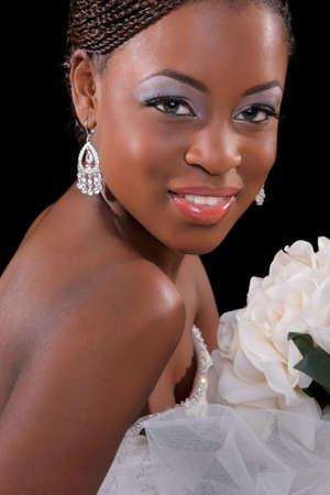 Beautiful African American Bride Portrait Sitting on Dark Background photo