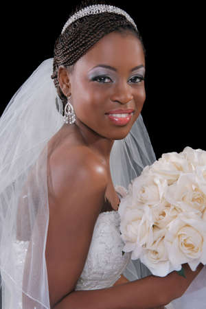 Beautiful African American Bride Portrait Sitting on Dark Background photo