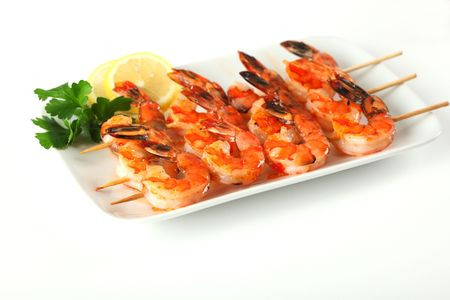Shrimp skewers with sweet garlic chili sauce on white background photo