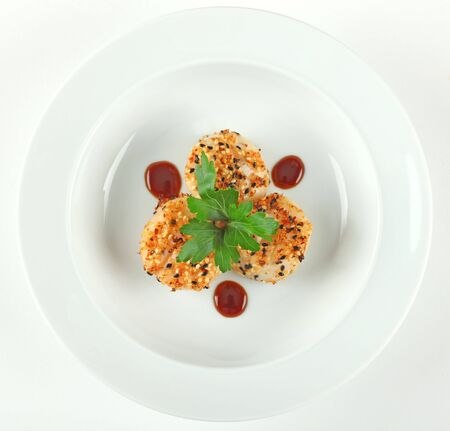 scallop seared with sesame seeds and ginger with hoisin sauce, garnished with parsley