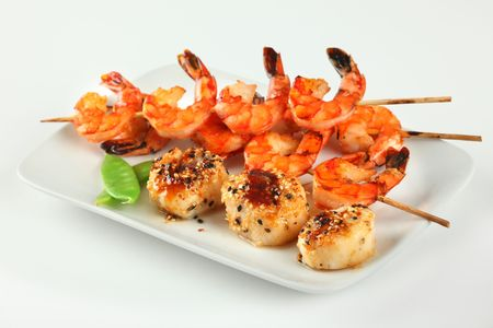 Plate of Asian Style Sesame ginger scallop with hoisin sauce and Shrimp Skewers