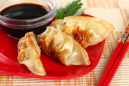 potstickers: Closeup of Fried Potstickers, Dumplings, Traditional Asian Food, Stuffed with Pork Meat or Vegetables