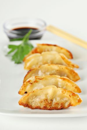 Fried Potstickers, Dumplings, Traditional Asian Food, Stuffed with Pork Meat or Vegatables