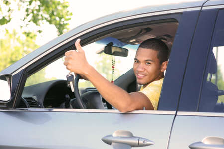 Young Smiling African American Male Thumb up in a Car Stock Photo - 5782254
